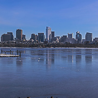 Boston winter photography showing mallard ducks forming the inner circle of trust on a frozen Charles River. The skyline is formed of familiar landmarks such as the Boston State Street Corporation, The Federal Reserve Bank of Boston, the Millennium Tower and the One Financial Center at Dewey Square on a bitter cold morning in winter. Boston winter photos are available as museum quality photography prints, canvas prints, acrylic prints, wood prints or metal prints. Fine art prints may be framed and matted to the individual liking and decorating needs at<br />  <br /> http://juergen-roth.pixels.com/featured/boston-inner-circle-of-trust-juergen-roth.html<br /> <br /> All photographs are available for digital and print image licensing at www.RothGalleries.com. Please contact me direct with any questions or request.<br /> <br /> Good light and happy photo making!<br /> <br /> My best,<br /> <br /> Juergen<br /> Prints: http://www.rothgalleries.com<br /> Photo Blog: http://whereintheworldisjuergen.blogspot.com<br /> Instagram: https://www.instagram.com/rothgalleries<br /> Twitter: https://twitter.com/naturefineart<br /> Facebook: https://www.facebook.com/naturefineart