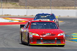 June 24, 2011; Sonoma, CA, USA;  NASCAR Sprint Cup Series driver Joe Nemechek (87) drives through turn 7 during practice for the Toyota/Save Mart 350 at Infineon Raceway.