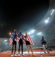 Friidrett<br /> OL 2008 Beijing<br /> Foto: Dppi/Digitalsport<br /> NORWAY ONLY<br /> <br /> 21.08.2008 <br /> <br /> USA's Lashawn Merritt (C), Jeremy Wariner (R) and David Neville, wrapped in their national flag, celebrate winning respectively gold, silver and bronze in the men's 400m final at the National stadium at the 2008 Beijing Olympic Games, August 21, 2008<br /> <br /> BILDET INNGÅR IKKE I FASTPAKKER