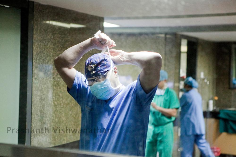 Professor, Juha Hernesniemi , prepares himself  before he performs a neurosurgery in front of 170 Indian neurosurgeons at Bombay Hospital in Mumbai, India, on Sunday, April 17, 2011. Photographer: Prashanth Vishwanathan/HELSINGIN SANOMAT