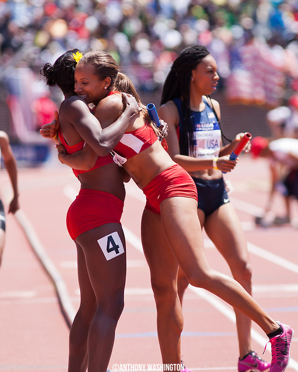 Alysia Montano with the USA Red team gets a hug from Lea Wallace following their first place finish in the USA vs. the World Women 4x800 during the 119th Penn Relays on Saturday, April 27, 2013 in Philadelphia, PA.