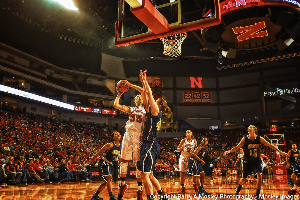 Huskers Jordan Hooper goes up for layup against Oral Roberts defender in 2013. Photo by Mosley Images, Lincoln, Nebraska