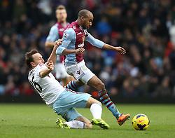 West Ham United's Mark Noble tackles Aston Villa's Fabian Delph - Photo mandatory by-line: Matt Bunn/JMP - Tel: Mobile: 07966 386802 08/02/2014 - SPORT - FOOTBALL - Birmingham - Villa Park - Aston Villa v West Ham United - Barclays Premier League