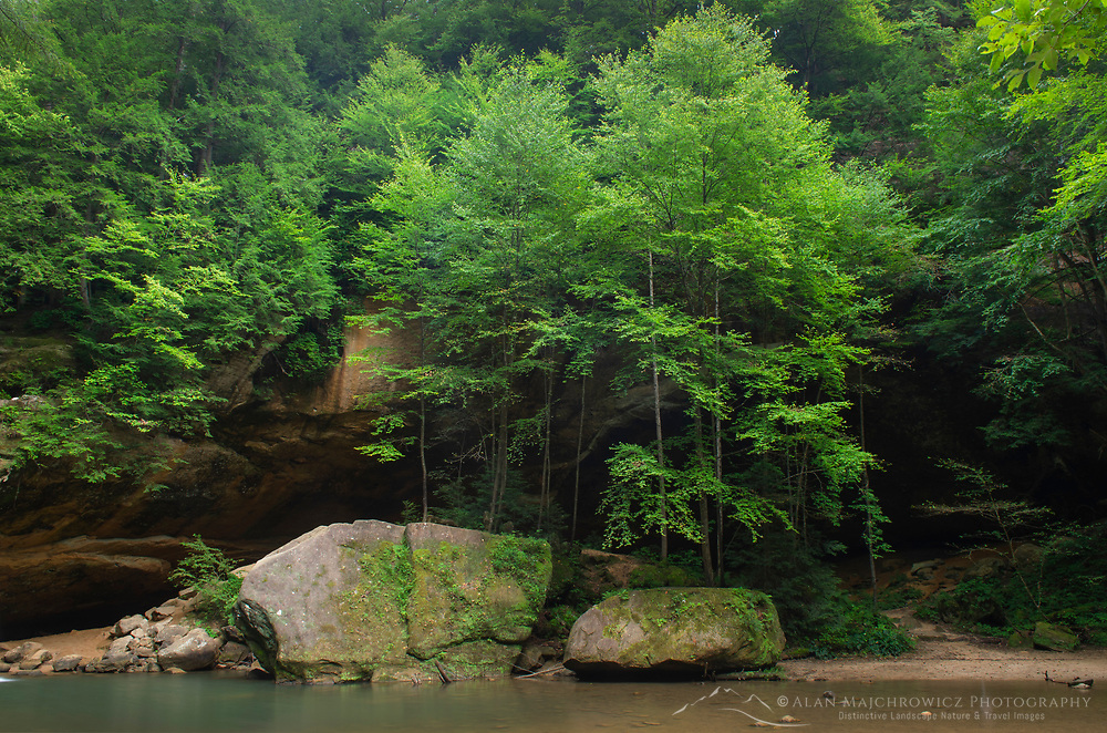 Deciduous trees and blouders at Old Man's Cave Lower Falls. Hocking Hills State Park Ohio