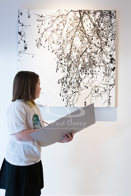 """Christies, St James, London, March 4th 2016. Nine year-old Ashley Hubbard from Charlton Manor Primary School draws Sue Arrowsmith's acrylic on canvas  """"When The Lights Are Low"""", 2012, at the preview for the It's Our World charity auction at Christie's. Over 40 leading artists including David Hockney, Sir Antony Gormley, David Nash, Sir Peter Blake, Yinka Shonibare, Sir Quentin Blake, Emily Young and Maggi Hambling have committed artworks to the It's Our World Auction in support of The Big Draw and Jupiter Artland Foundation, to be sold at Christie's London on 10 March 2016.<br />  ///FOR LICENCING CONTACT: paul@pauldaveycreative.co.uk TEL:+44 (0) 7966 016 296 or +44 (0) 20 8969 6875. ©2015 Paul R Davey. All rights reserved."""