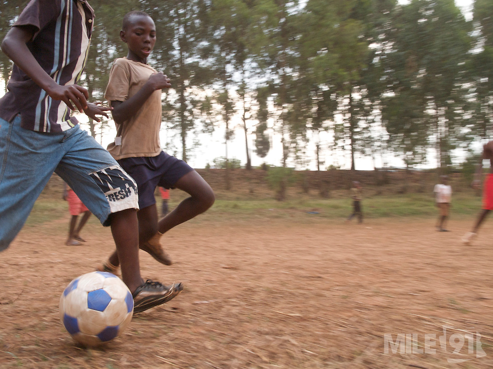Young boys playing football during the World Cup in South Africa, Ngoma district, Rwanda.