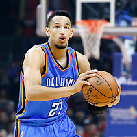 21 December 2015:  Oklahoma City Thunder guard Andre Roberson (21) brings the ball up court during the Oklahoma City Thunder 100-99 victory over the Los Angeles Clippers, at the Staples Center, Los Angeles, California, USA.