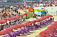 Tale of two beaches-Palestinians crowd the Mediteranean beach of Gaza City on the traditional Muslim day of rest Friday, July 27, 2001. Despite the  violence Israelis and Palestinians take a break to enjoy the Mediterranean beaches and the Dead Sea, where under growing tensions and in the case of Gaza under closure people try to  make the best of their summer and carry on a normal life.