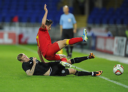 James McClean of Republic of Ireland (Wigan) tackles Joe Allen of Wales (Liverpool)  - Photo mandatory by-line: Joe Meredith/JMP - Tel: Mobile: 07966 386802 14/08/2013 - SPORT - FOOTBALL - Cardiff City Stadium - Cardiff -  Wales V Republic of Ireland - International Friendly