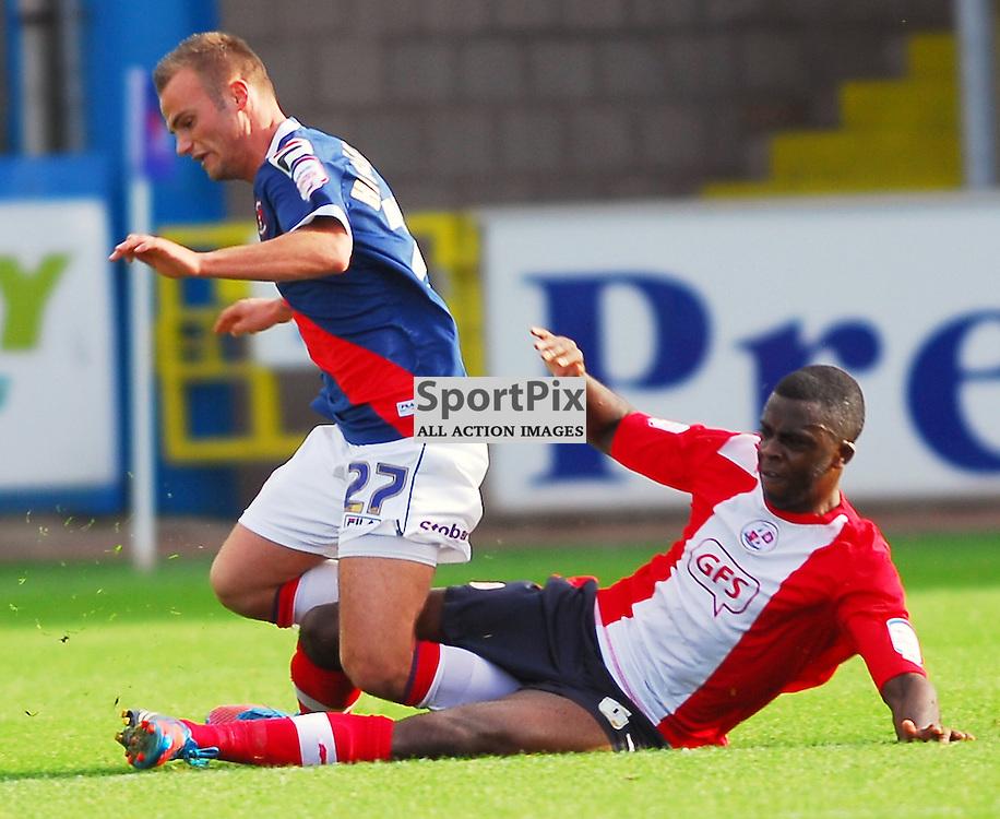 Kallum Higginbotham (Carlisle United, blue) is tackled by Hope Akpan..Carlisle v Crawley, Npower League One, 29th September 2012..(c)  Alex Todd   StockPix.eu