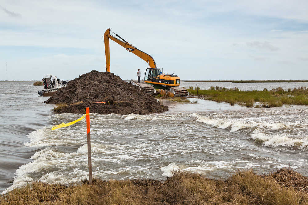 Plaquemines Parish, Louisiana- August 31, State crews intentionally breach a back levee to help Hurricane Isaac flood waters recede.