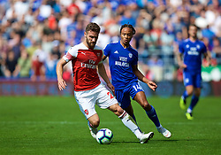 CARDIFF, WALES - Sunday, September 2, 2018: Arsenal's Shkodran Mustafi and Cardiff City's Bobby Reid during the FA Premier League match between Cardiff City FC and Arsenal FC at the Cardiff City Stadium. (Pic by David Rawcliffe/Propaganda)