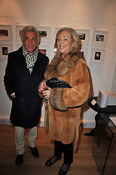 GIANCARLO GIAMMETTI and PAULA BECKWITH at a party to launch Alistair Taylor-Young's new book 'The Phone Book' held at The Little Black Gallery, 13A Park Walk, London SW10 on 18th January 2011.