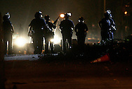 Sept. 7, 2010 - Los Angeles, California, U.S - Los Angeles Police in riot gear patrol a Westlake street as protesters and officers clashed Tuesday night in Westlake near the site of a deadly officer involved shooting that occurred on Monday. The confrontation came after a police sign was torn down and objects thrown at the windows of the Rampart station. About 300 people blocked Union Avenue and Sixth Street earlier in the evening, according to the report. Rocks and bottles were being thrown shortly after 9:30 p.m. Manuel Jamines, a 37-year-old Guatemalan construction worker and father of three, who was reportedly drunk and threatening people near Sixth Street and Union Avenue. He shot and killed by an LAPD bicycle officer after he allegedly ignored orders to a knife he was holding and instead lunged at them, prompting one of the officers to shoot him, police reported. (Credit Image: © Jonathan Alcorn/ZUMApress.com)