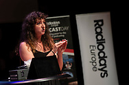 Event Photography images taken during the 2018 Podcast Day, held at The Black Diamond (Den Sorte Diamant) in Copenhagen, Denmark.  <br /> <br /> A guest speaker entertains from the stage.  <br /> <br /> © Event Photographer in Copenhagen Matthew James