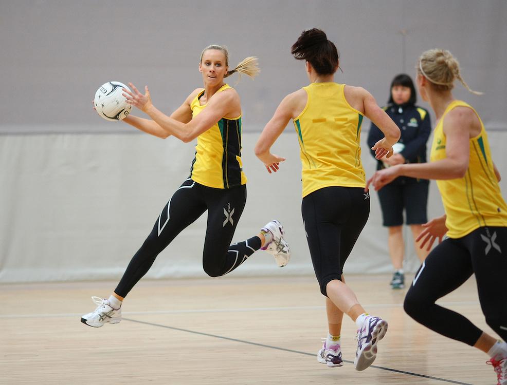 Australia's Renae Hallinan looks to pass the ball at training for the New World Quad series netball match against England, TECT Arena, Tauranga, New Zealand, Saturday, October 27, 2012. Credit:SNPA / Dianne Manson.