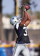 Dallas Cowboys free safety Byron Jones (31) leaps to catch a pass during the second day of the Dallas Cowboys 2016 NFL training camp football practice held on Sunday, July 31, 2016 in Oxnard, Calif. (©Paul Anthony Spinelli)