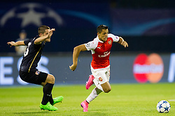 Arijan Ademi #16 of GNK Dinamo Zagreb and Alexis Sanchez #17 of Arsenal F.C. during football match between GNK Dinamo Zagreb, CRO and Arsenal FC, ENG in Group F of Group Stage of UEFA Champions League 2015/16, on September 16, 2015 in Stadium Maksimir, Zagreb, Croatia. Photo by Urban Urbanc / Sportida