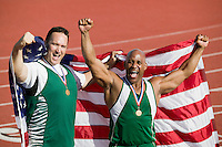 Two male athletes enjoying victory, portrait