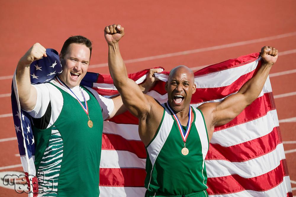 Two male athletes enjoying victory, portrait