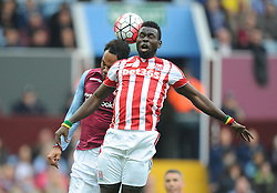 Mame Biram Diouf of Stoke City wins a high ball over Joleon Lescott of Aston Villa - Mandatory byline: Alex James/JMP - 07966 386802 - 03/10/2015 - FOOTBALL - Villa Park - Birmingham, England - Aston Villa v Stoke City - Barclays Premier League