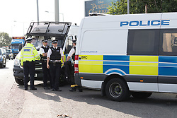 © Licensed to London News Pictures. 05/06/2017. LONDON, UK.  Police officers and vans outside a residential address in Dagenham this morning. Police carried out a raid at a Dagenham address early this morning in connection with the London Bridge terror attacks and residents reported hearing gun shots.  Photo credit: Vickie Flores/LNP