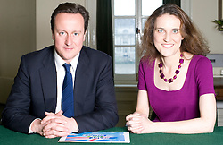 Leader of the Conservative Party David Cameron with Theresa Villiers, Member of Parliament for Chipping Barnet in his office in Norman Shaw South, January 18, 2010. Photo By Andrew Parsons / i-Images.