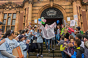 Campaigners against the closure by Lambeth council  of Carnegie Library in Herne Hill, south London, emerge from the premises into the street on their 10th day of occupation, 9th April 2016. The local community have been occupying their important resource for learning and social hub and after a long campaign, Lambeth have gone ahead and closed the library's doors for the last time because they say, cuts to their budget mean millions must be saved. They plan to re-purpose it into a gym although details are unknown.