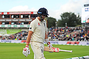 Wicket - Joe Root of England looks dejected as he walks back to the pavilion after being dismissed by Josh Hazlewood of Australia during the International Test Match 2019, fourth test, day three match between England and Australia at Old Trafford, Manchester, England on 6 September 2019.