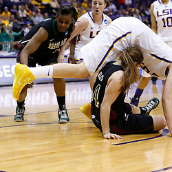 Mar 24, 2013; Baton Rouge, LA, USA; Green Bay Phoenix guard Megan Lukan (14) collides with LSU Tigers forward Theresa Plaisance (55) in the second half of the first round of the 2013 NCAA womens basketball tournament at the Pete Maravich Assembly Center.  LSU defeated Green Bay 75-71. Mandatory Credit: Derick E. Hingle-USA TODAY Sports