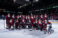 KELOWNA, CANADA - MARCH 10: The Kelowna Rockets pose on the ice after the win against the Kamloops Blazers in their Don Cherry fundraiser jerseys on March 10, 2018 at Prospera Place in Kelowna, British Columbia, Canada.  (Photo by Marissa Baecker/Shoot the Breeze)  *** Local Caption ***
