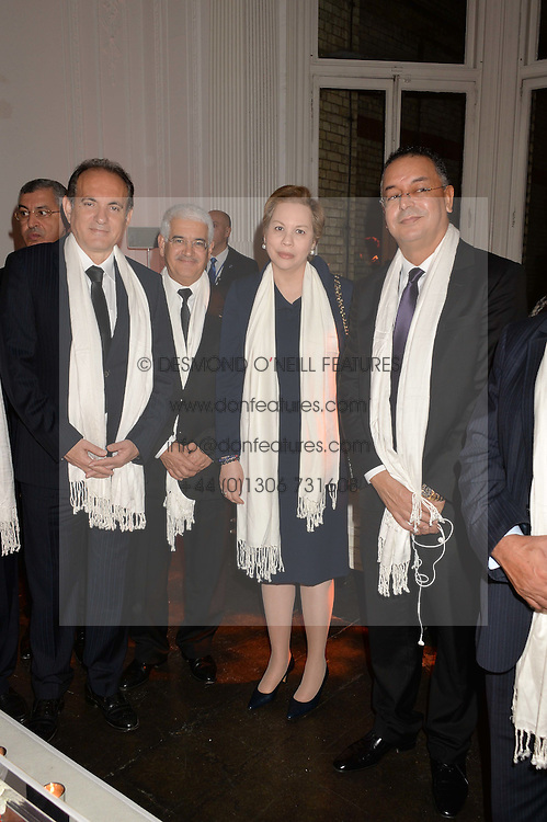 Left to right,  ABDERRAFIE ZOUITEN General Manager of The Moroccan National Tourist Office, SALAH EDDINE BENHAMMANE President of the Tourism Committee of Agadir Souss Massa Draa, HH PRINCESS LALLA JOUMALA OF MOROCCO and LAHCEN HADDAD the Moroccan Minister of Tourism at White by Agadir hosted by the Moroccan National Tourist Office to celebrate the White City in Morocco in the presence of H.H.Princess Lalla Joumala, Ambassador of HM The King of Morocco held at Il Bottaccio, 9 Grosvenor Place, London on 4th November 2014.