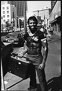 A built guy holding his ghetto blaster on the street in Downtown SanFrancisco, USA, 1980