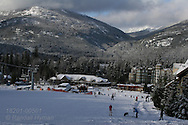 Blackcomb Mountain's final ski run leads to Blackcomb Daylodge; Whistler, British Columbia, Canada.
