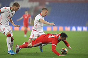 Wales forward Kiefer Moore is tackled during the Friendly match between Wales and Belarus at the Cardiff City Stadium, Cardiff, Wales on 9 September 2019.