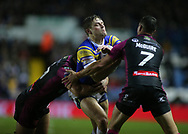 Jimmy Kienhorst (c) of Leeds Rhinos tackled by Tommy Lee (L) and Danny McGuire (R) of Hull Kingston Rovers during the Betfred Super League match at Elland Road, Leeds<br /> Picture by Stephen Gaunt/Focus Images Ltd +447904 833202<br /> 08/02/2018