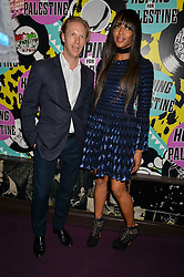 NAOMI CAMPBELL and JAN OLESEN at Hoping's Greatest Hits - the 10th Anniversary of The Hoping Foundation's charity benefit held at Ronnie Scott's, 47 Frith Street, Soho, London on 16th June 2016.