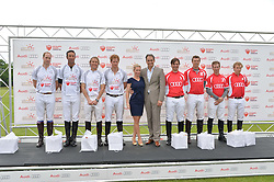 Left to right, HRH THE DUKE OF CAMBRIDGE, JOHN PAUL CLARKIN, MARK TOMLINSON, HRH PRINCE HARRY, CHRISTINE SIEG, ANDRE KONSBRUCK Director of Audi UK, MICHAEL BICKFORD, JAMES HARPER, JAMES BEIM and JAMES MESQUITA at the Audi Polo Challenge at Coworth Park, Blacknest Road, Ascot, Berkshire on 31st May 2015.