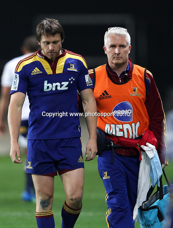A dejected Ben Smith leaves the field after suffering a concussion.<br /> Investec Super Rugby - Highlanders v Stormers, 7 April 2012, Forsyth Barr Stadium, Dunedin, New Zealand.<br /> Photo: Rob Jefferies / photosport.co.nz