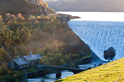 © Licensed to London News Pictures. 07/11/2019. Rhayader, Powys, Wales, UK. Water cascades over the Caban Coch dam in an autumnal landscape after recent heavy rainfall replenished water levels in the Elan Valley reservoir complex near Rhayader in Powys, UK. Photo credit: Graham M. Lawrence/LNP