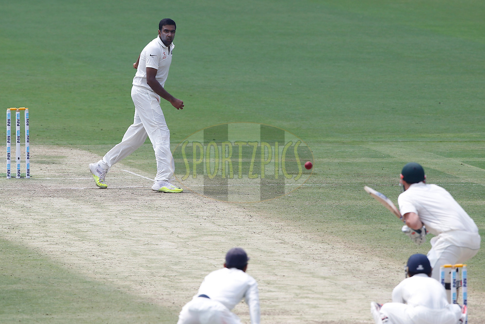 Ravichandran Ashwin of India bowls a delivery during day two of the second test match between India and Australia held at the M Chinnaswamy Stadium in Bangalore on the 5th March 2017. <br /> <br /> Photo by: Deepak Malik / BCCI/ SPORTZPICS