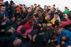 The Haxey Hood. Locals fight for the Hood (a leather tube) during the Haxey Hood game. Haxey Hood is described as a kind of rugby game with unlimited participants and few rules, where a leather tube is slowly walked by a large unorganised rugby scrum to 1 of 4 pubs, Haxey, United Kingdom. Monday, 6th January 2014. Picture by Peter Kollanyi / i-Images