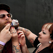 Brandon Biggins gets some help attaching a Pabst Blue Ribbon beer can to his beard from Nicole Fisher, his best friend, in Bend, Oregon on Saturday, June 5, 2010 at the Beard Team USA National Beard and Mustache Championships. Biggins ultimately used two cans and entered in the freestyle portion of the competition.
