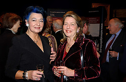 Left to right, GENEVIEVE MATHER and the HON.MRS WHITE at a reception hosted by Brian Ivory Chairman of the Trustees of The National Galleries of Scotland to commemorate Sir Timothy Clifford's 21 years of Director of the National Gallery of Scotland and his forthcoming retirement in January 2006, held at Christie's, King Street, London W1 on 6th December 2005.<br />