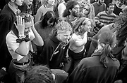 Protestor blowing whistle in dancing crowd, Reclaim the Streets, Trafalgar Square, London, May 1997