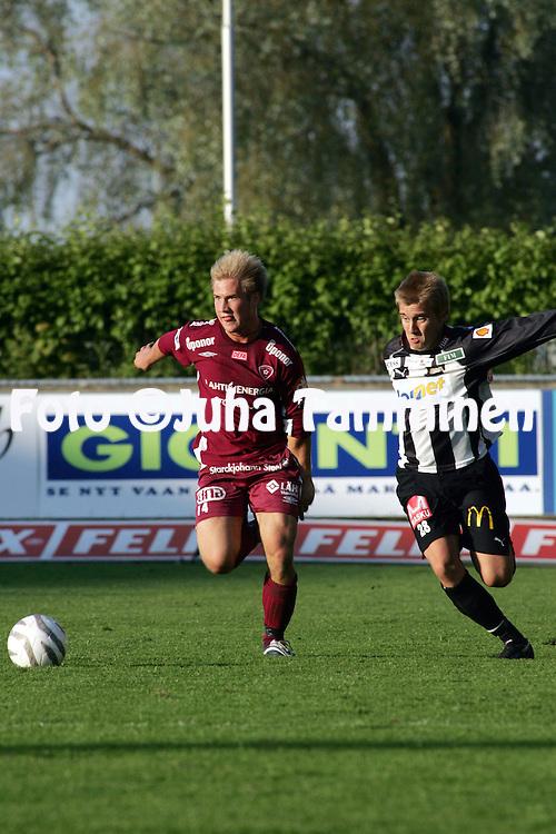 15.06.2005, Veritas Stadion, Turku, Finland..Veikkausliiga 2005 / Finnish League 2005.TPS Turku v FC Lahti.Joonas Siikala (FC Lahti) v Jani Virtanen (TPS).©Juha Tamminen.....ARK:k
