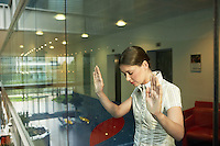 Woman Behind Glass Wall in office