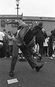 Dancer improvising new movements at Notting Hill Carnival, 1990's