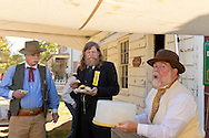 Old Bethpage, New York, U.S. 29th September 2013. L-R, GUY SMITH of Huntington, and NORMAN ERIKSON, of Greenlawn, who is wearing a reproduction of a yellow Reunion Ribbon for the Grand Army of the Republic, Moses Baldwin Post 544, eat as they look at another Civil War re-enactor make a funny face while carrying a cake holder, at The Long Island Fair. A yearly event since 1842, the county fair is now held at a reconstructed fairground at Old Bethpage Village Restoration.