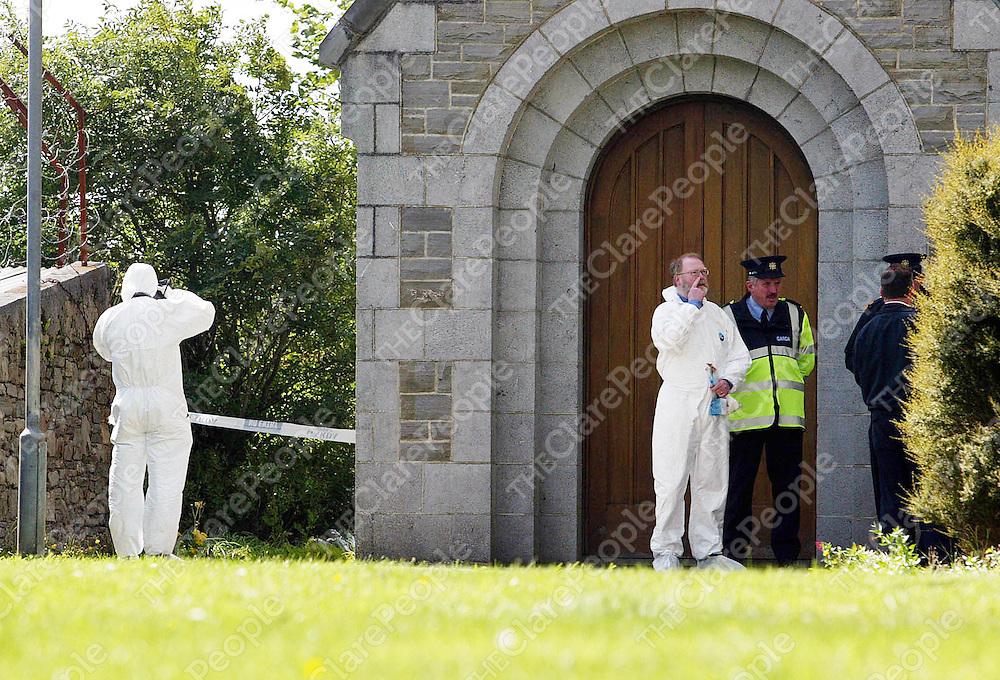 250805<br />Garda Technical Bureau and assistant state pathologist Dr Michael Curtis at St Senans Church Kilrush Co Clare.Pic Arthur Ellis/Press 22.